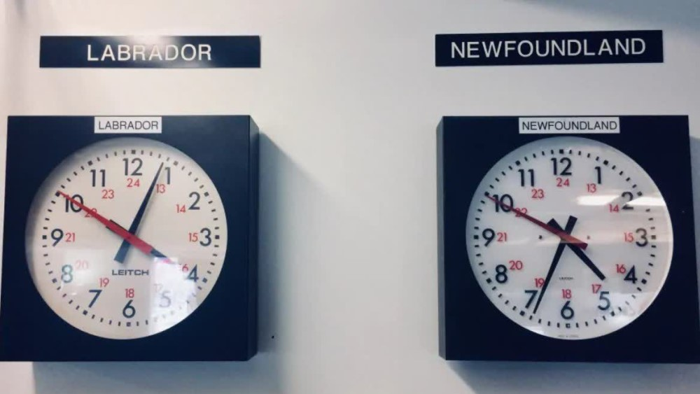 Two clocks are hanging together - the left one is with Labrador time, the right one with Newfoundland time